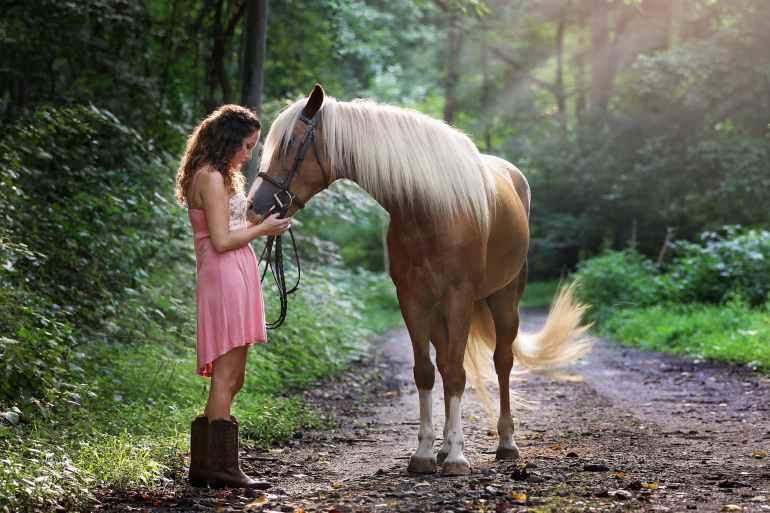 woman affectionate with horse